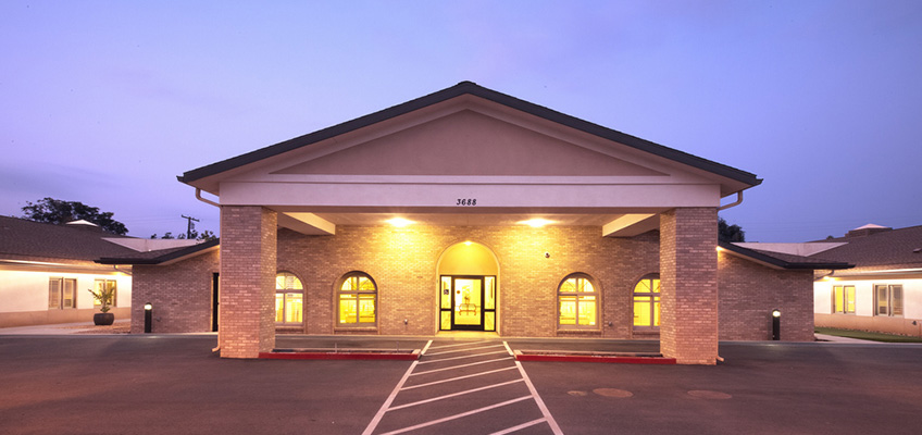 front of the facility during the evening with lights on