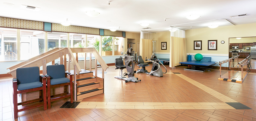 large rehabilitation area with various physical therapy machines