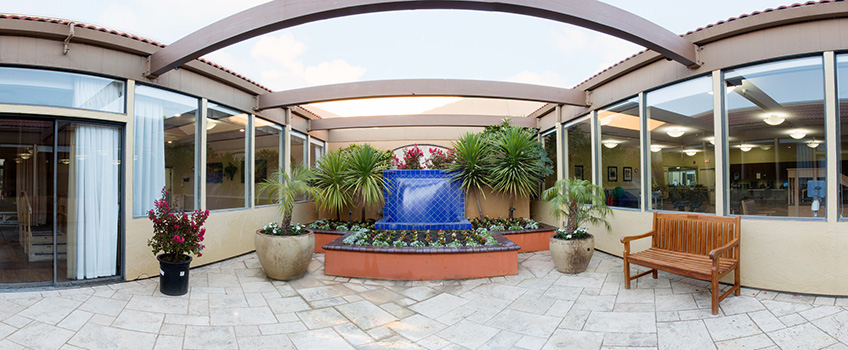 courtyard area with a blue tiled fountain