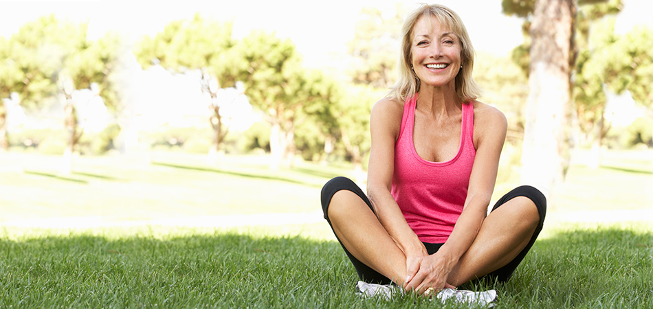 mature woman exercising outdoors