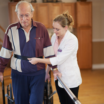 resident participating in walking therapy