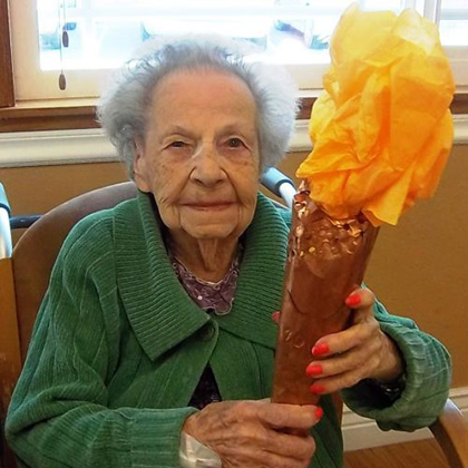 resident participating in holiday celebration
