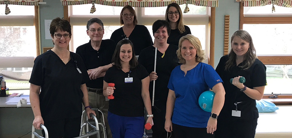 physical therapists smiling together