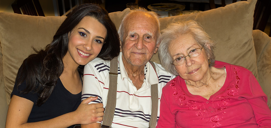 Residents smiling with their grand child happily
