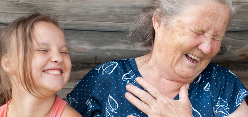 resident and her grandchild laughing together