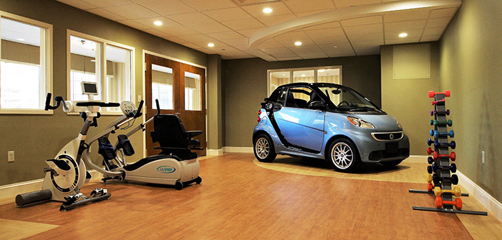 Nursing Home Southbury rehabilitation gym including equipment, and a car for practice.