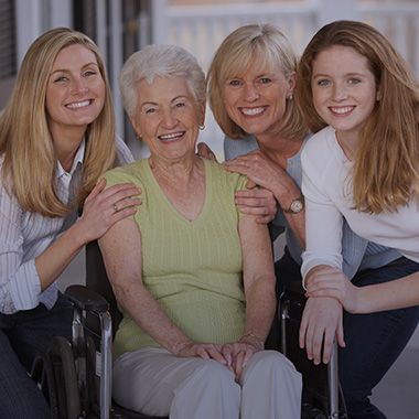 A grandmother surrounded by her daughter and granddaughters