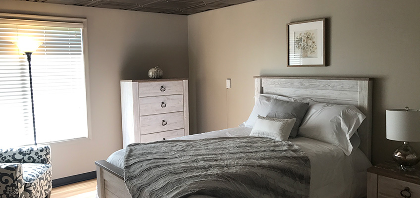 Cozy bedroom with a decorative chair beside the window