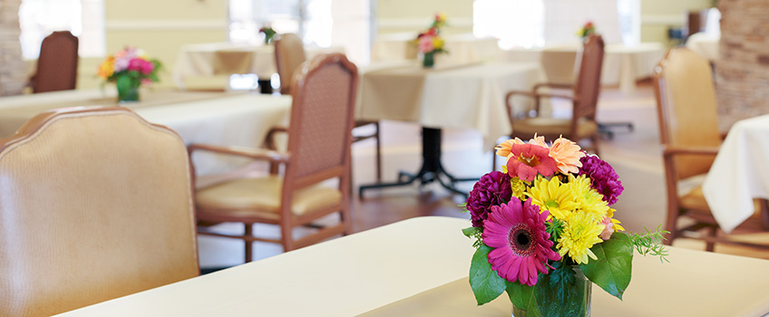dining area with close up on flower centerpiece