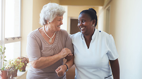 resident and nurse smiling at each other