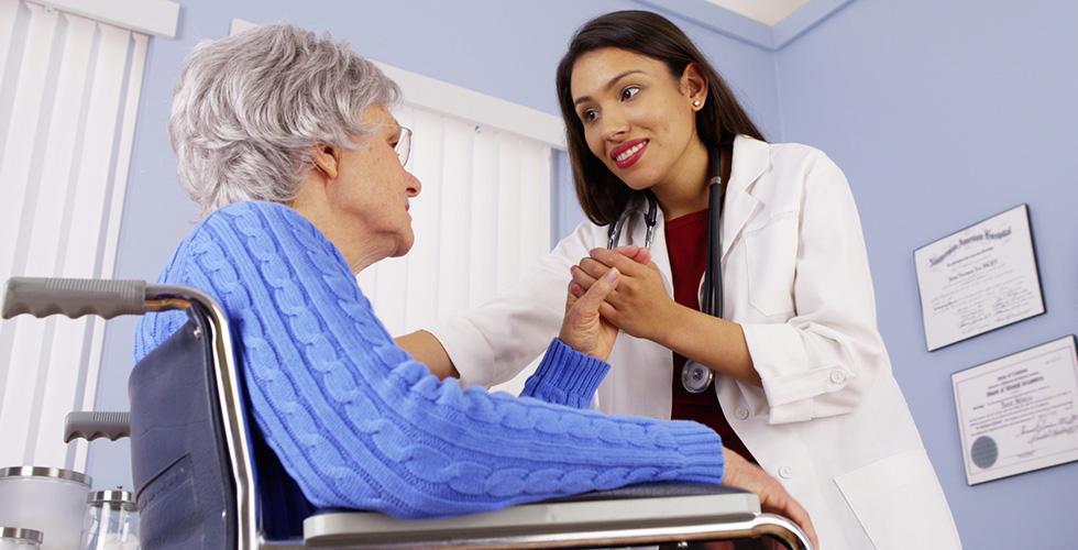 doctor holding hand of resident