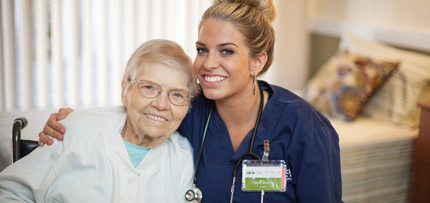 smiling resident and smiling nurse