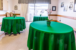 dining room with festive green tablecloths