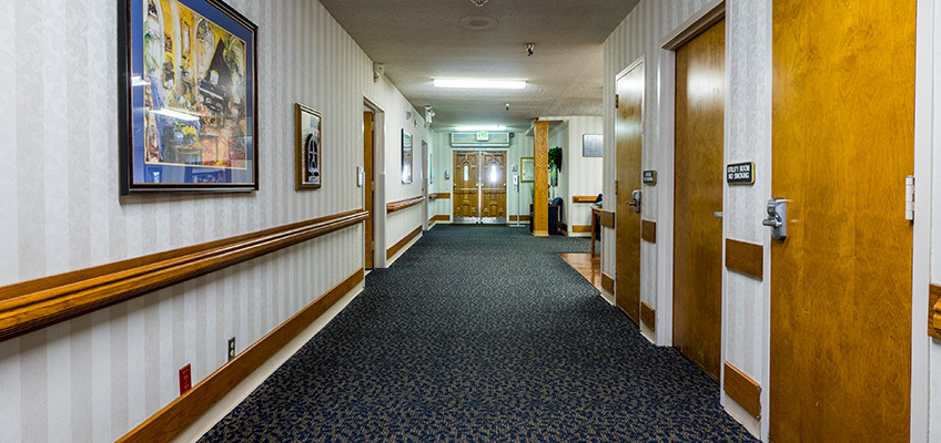 long clean hallway leading to exit doors