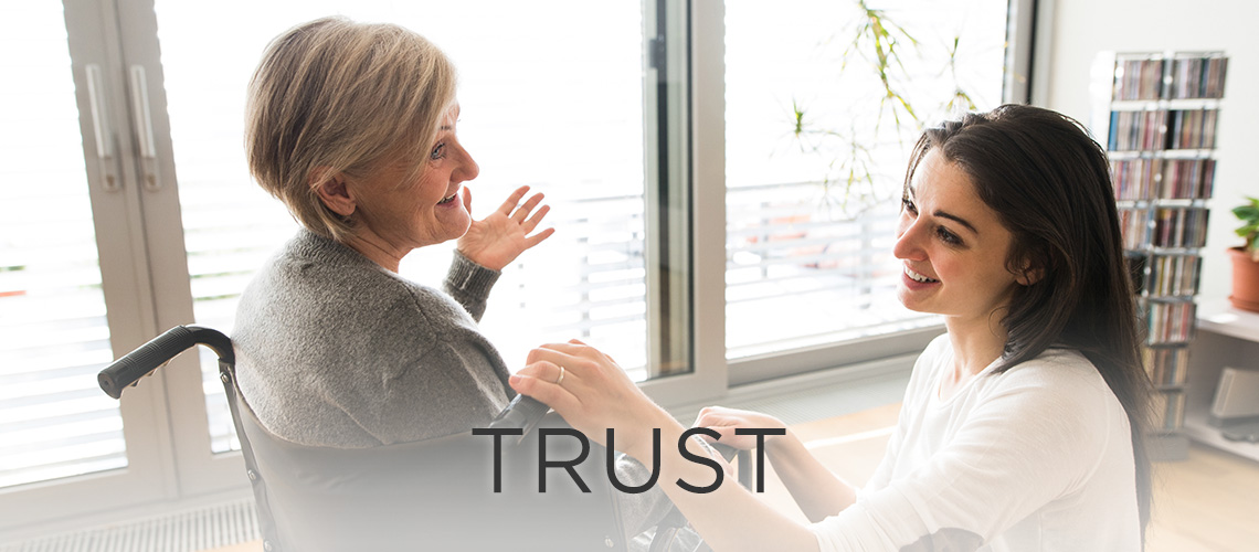 Woman smiling with the word trust to the left