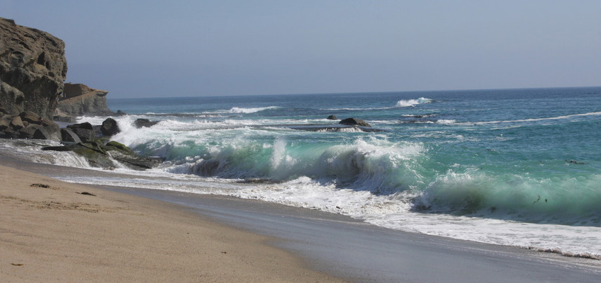 Crashing waves on the beach in Capistrano Beach