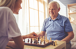 A man and woman playing a game of chess