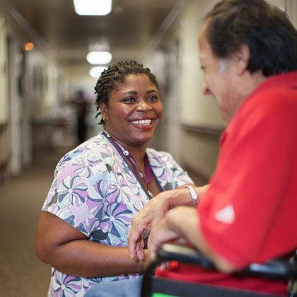 nurse helping a man in wheelchair