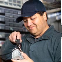 maintenance worker using a screw driver