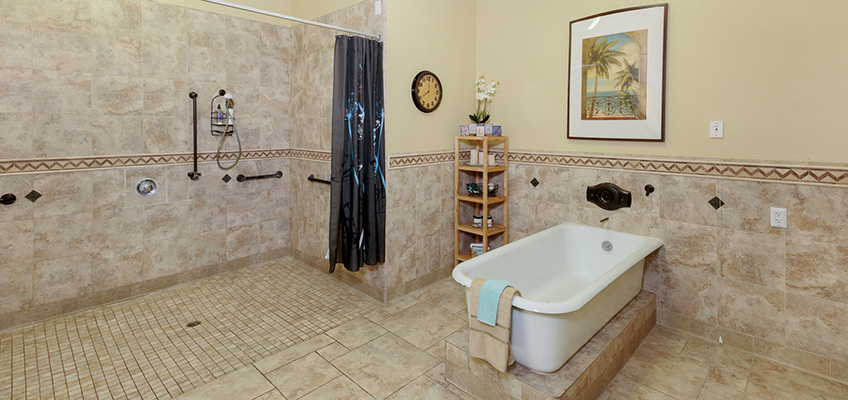shower area with a large shower, painting and a tub
