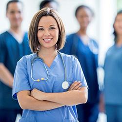 Nurse in scrubs with a stethoscope around her neck
