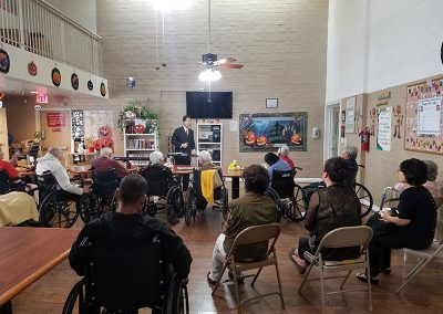 A presentation being given to some residents