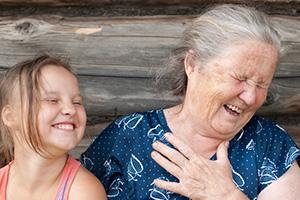 grandma having a good laugh with her granddaughter