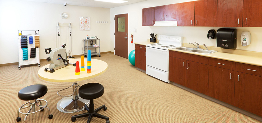 rehabilitation room with carpeted floor and various equipment