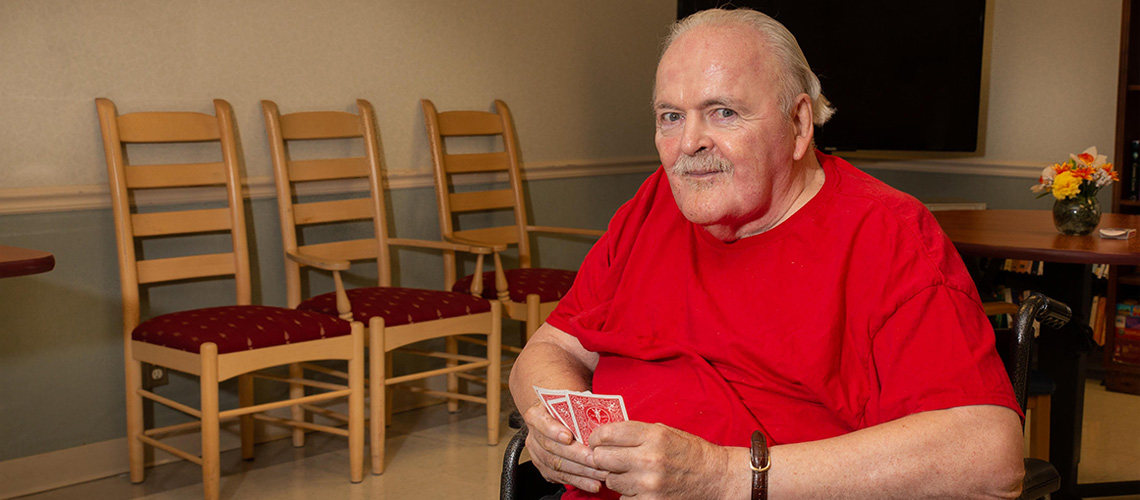 A resident playing cards.