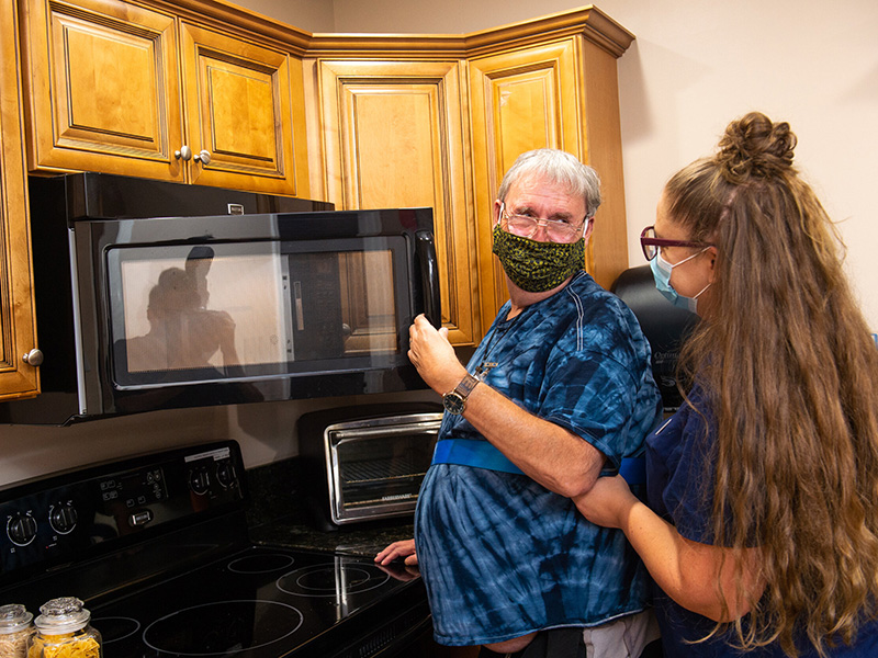 nurse cooking with a patient