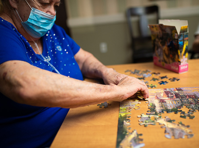 residents putting a puzzle together