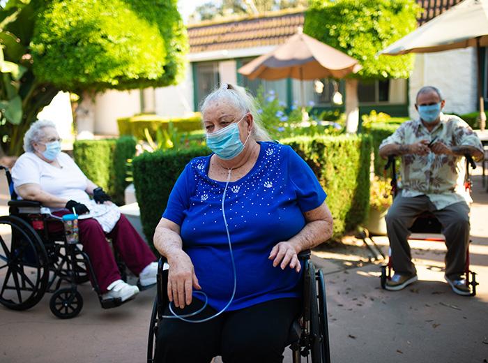 resident sitting in wheelchair