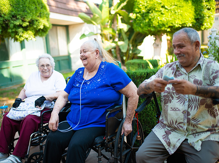 residents sitting and smiling together