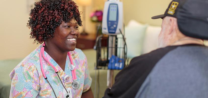 smiling nurse speaking to resident