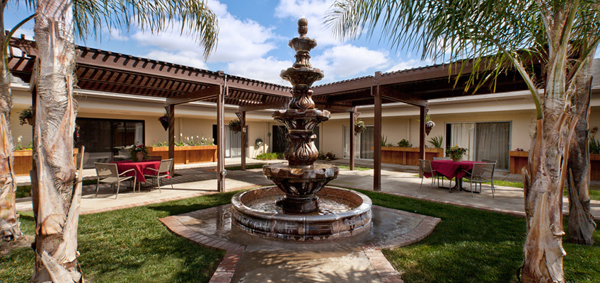 outside of the building with a fountain