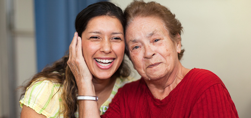 smiling woman and elderly woman