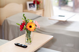 flowers on a bedside table in a two bed room