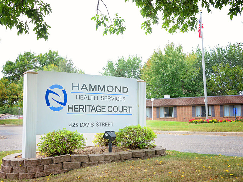 Hammond Health Services and Heritage Court sign out front of the building.