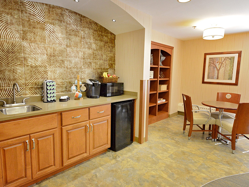 Resident lounge space with an areas for beverages and snacks.