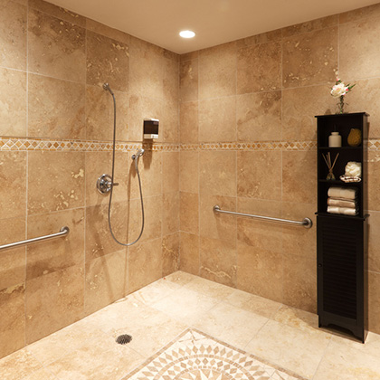 shower area with nice tiled floor and walls