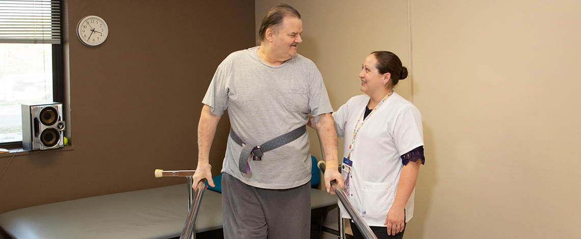 A nurse helping a man with his range of motion