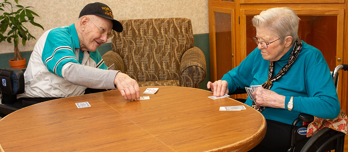 Two residents playing cards with each other.