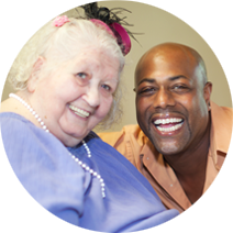 older woman enjoying a special event, smiling with another man