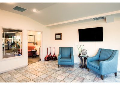 Lobby area with flat screen TV mounted on the wall and comfortable seating.
