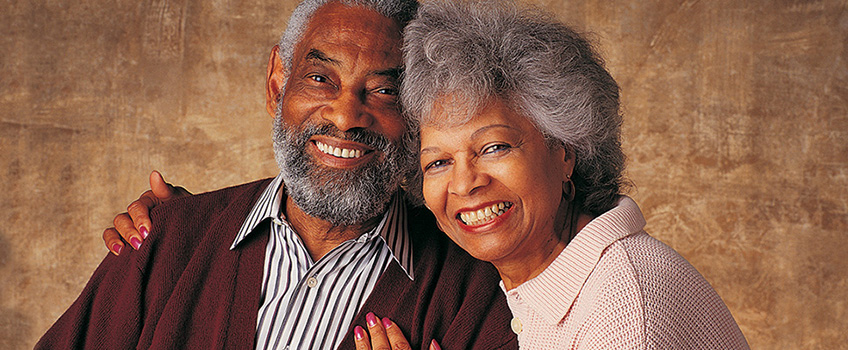 An older couple smiling together