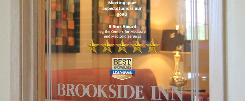 Brookside Inn entrance with the US NEWs 2015 logo and 5 star award stars.
