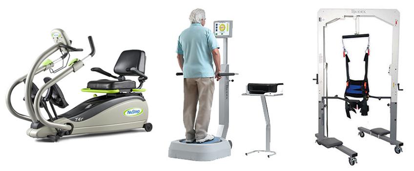 A senior standing on equipment beside state-of-the-art rehabilitation equipment.
