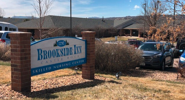 Brookside Inn sign and parking lot
