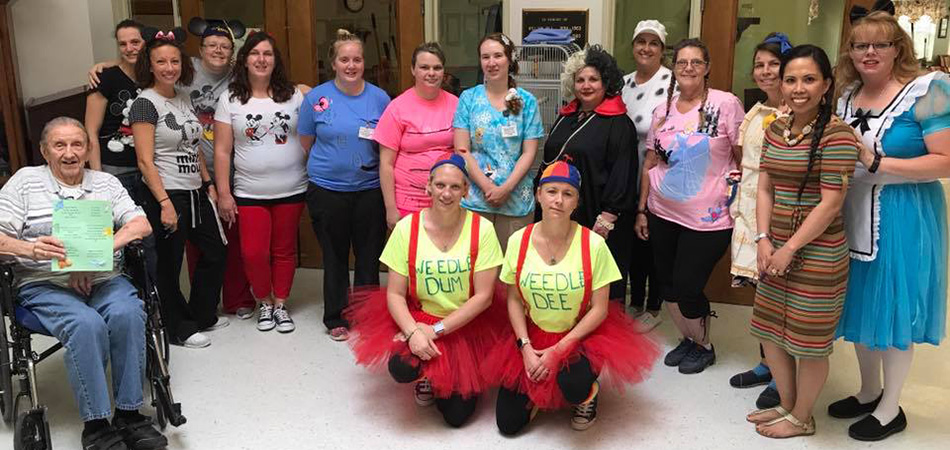 Staff members dressed up for Halloween