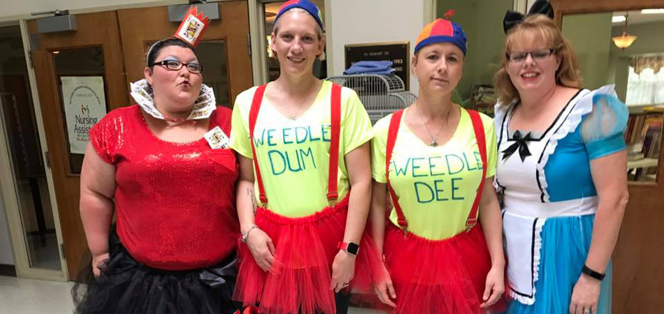Staff members dressed like characters from snow white